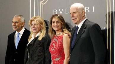La baronesa Thyssen con Paolo Bulgari y su esposa, en la fiesta celebradaen la embajada italiana, la noche del lunes.