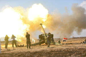 Members of Hashid Shaabi or Popular Mobilization Forces (PMF) fire towards Islamic State militant positions in west of Mosul
