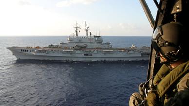 �Por qu� Merkel, Renzi y hollande se han reunido en un portaaviones?