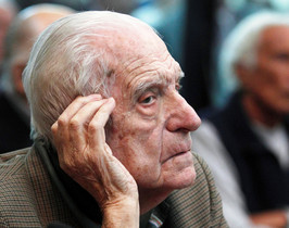 Argentinas former President and Army Chief Reynaldo Bignone sits in a courthouse during the first day of his trial, accused of participating in Operation Condor, in Buenos Aires