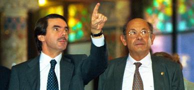 Aznar y Millet, en diciembre del 2002.