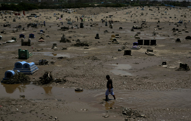 View of a damaged cemetary after rainfall and flood in Trujillo, northern Peru
