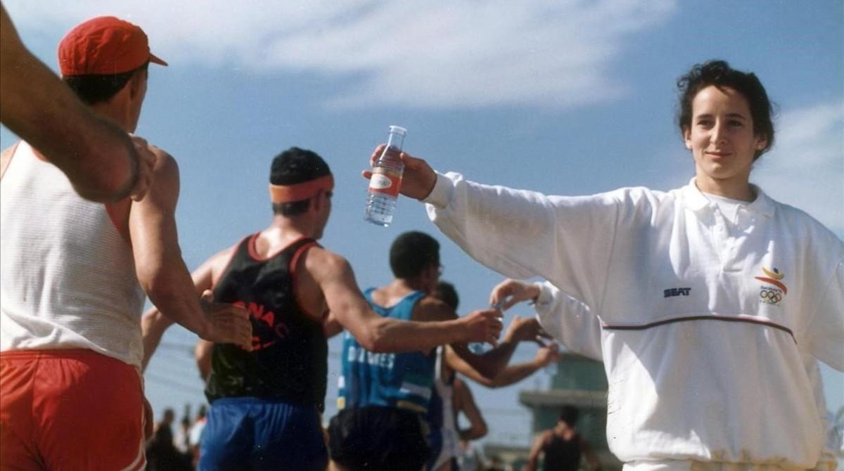 Voluntarios olímpicos durante la prueba de maratón.
