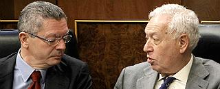 Los ministros de Justicia y Exteriores.
