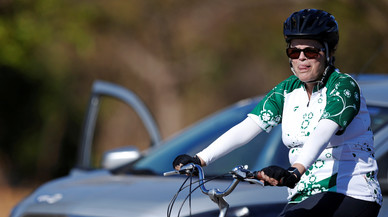 Brazil's suspended President Dilma Rousseff rides her bicycle near the Alvorada Palace in Brasilia