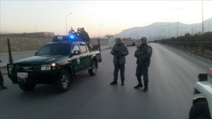 mbenach36828296 afghan policemen stand guard at the site of a suicide bomb a170110141259