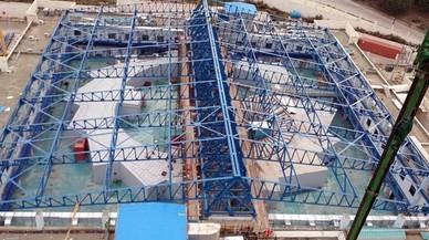 El sincrotr�n Sesame,enJordania,con el techo sin tapiar durante su fase de construcci�n, loque permite apreciar la estructura circular del acelerador de part�culas.