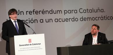 Puigdemont y Junqueras, durante la conferencia en Madrid.