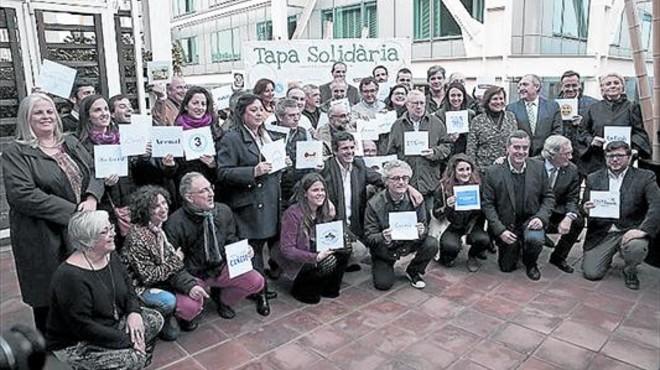 Restauradores que han participado en la campa�a 'Tapa Solid�ria'.