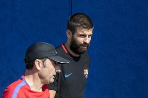 Valverde y Piqué, en un entrenamiento.