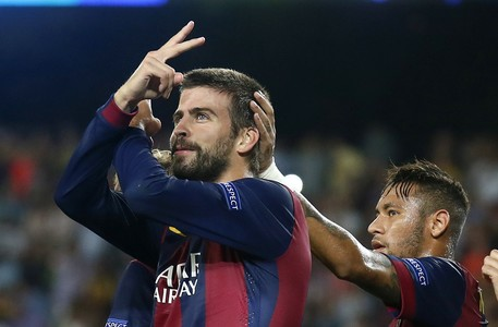 Barcelona's Gerard Pique celebrates a goal next to Neymar against Apoel Nicosia during their Champions league soccer match in Barcelona