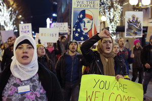 People march through downtown Seattle during a protest held in response to President Donald Trumps travel ban, in Seattle