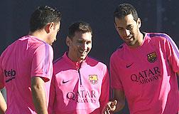 Busquets, en el entrenamiento del viernes con junto a Messi y Xavi