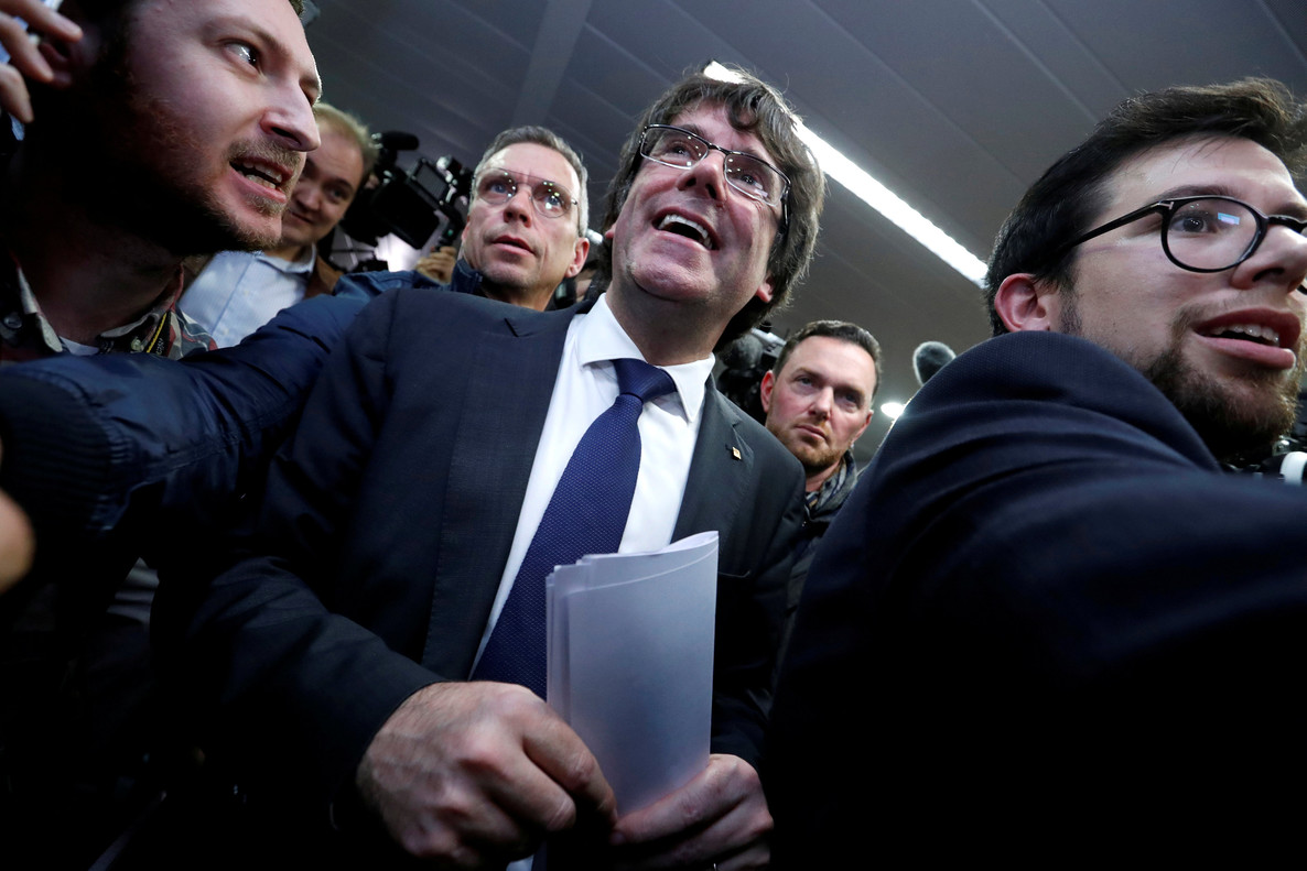 Sacked Catalan leader Carles Puigdemont departs after a news conference in Brussels
