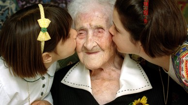 The World's oldest woman, Jeanne Calment, 120 years old, is kissed by two young girls during a special ceremony in a retirement home in Arles