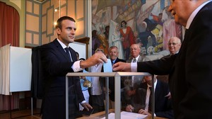 undefined38939175 french president emmanuel macron casts his ballot as he vote170618222433