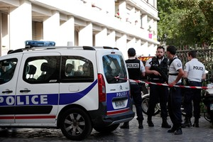 Police secure the area near the scene where French soliders were hit and injured by a vehicle in the western Paris suburb of Levallois-Perret