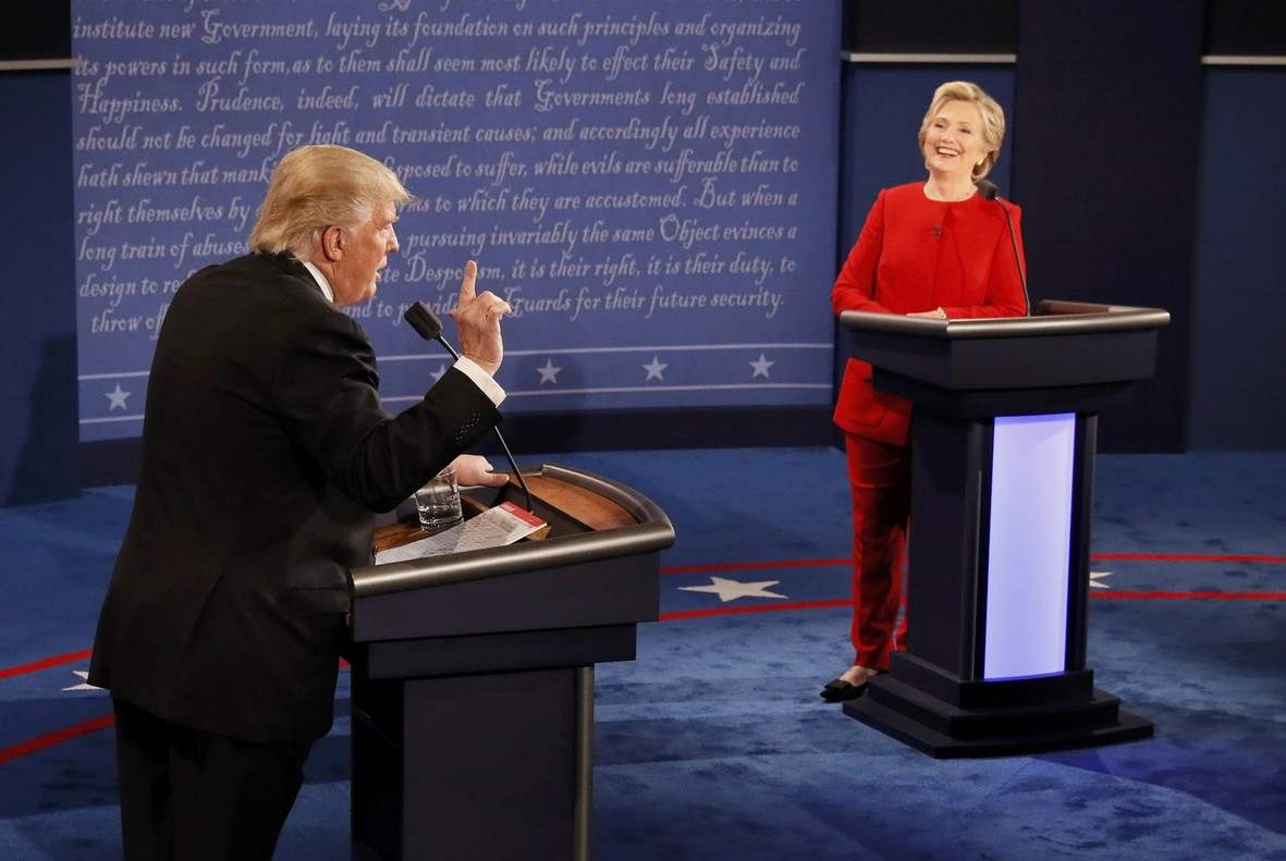 Republican U.S. presidential nominee Donald Trump speaks as Democratic U.S. presidential nominee Hillary Clinton listens during their first presidential debate at Hofstra University in Hempstead