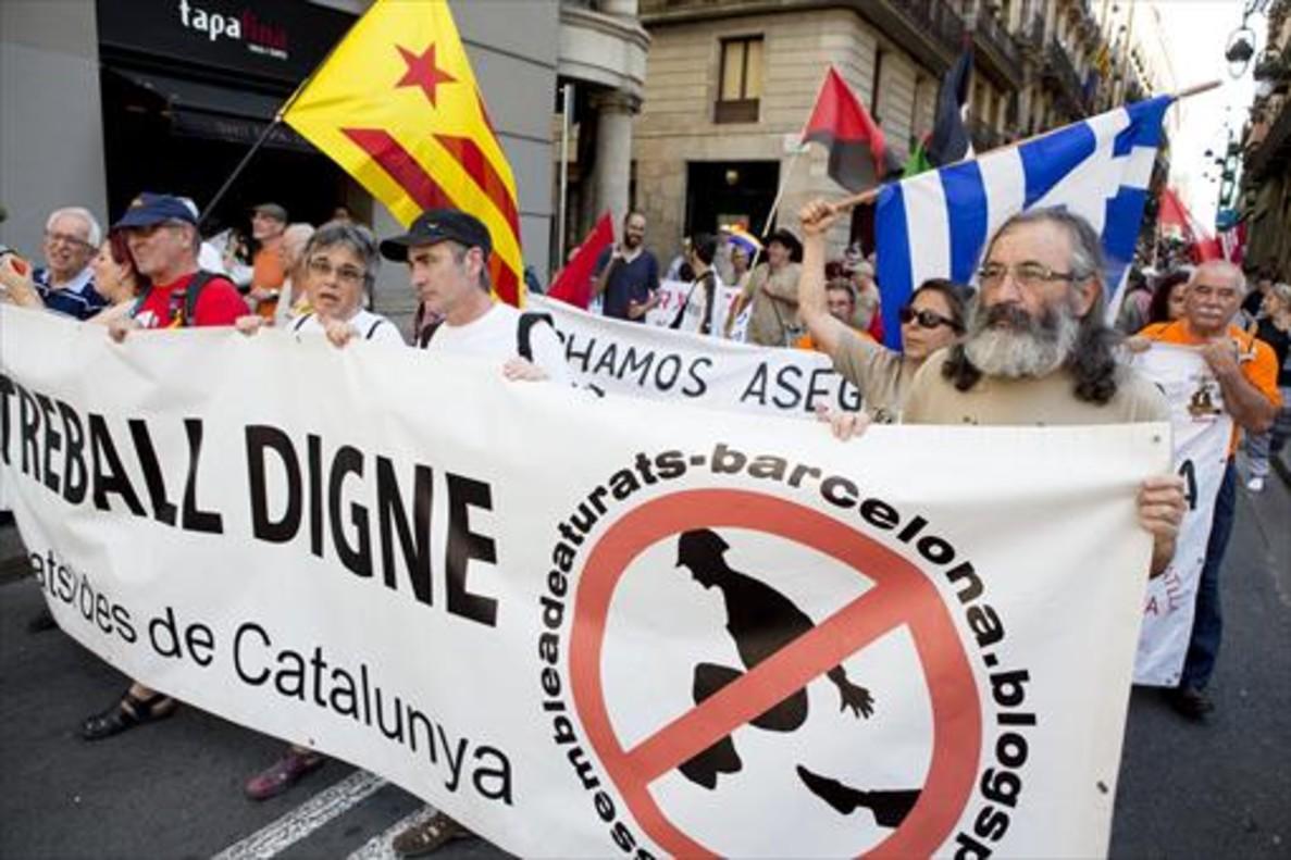 Protesta 8 Marcha contra la precariedad laboral en Barcelona, en julio del 2015.