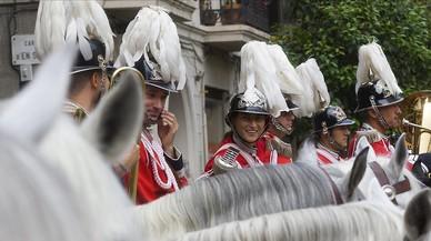Miembros de la banda de música de la Guardia Urbana, en una procesión de la Mercè.