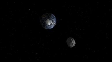 Simulación artística del asteroide 2015 TC25 durante su máxima aproximación a la Tierra.