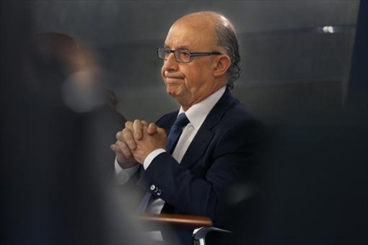Cristóbal Montoro, ministro de Hacienda, en la rueda de prensa del Consejo de Ministro del 10 de julio.