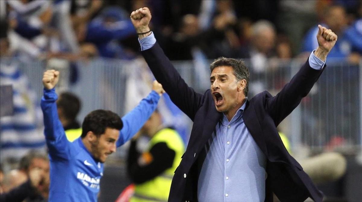 Michel celebra un gol del Málaga en el partido contra el Sevilla.