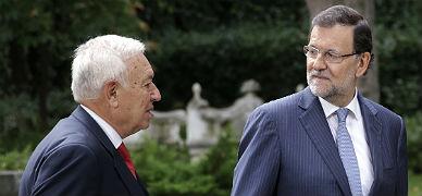 Rajoy y Margallo, en Madrid, ayer.