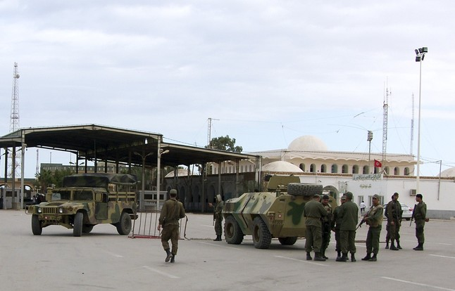 File photo of Tunisian soldiers stand guard at the border crossing at Ras Jdir Ben Guerdane, southeast of Tunis