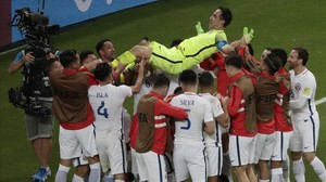 rpaniagua39094434 chile goalkeeper claudio bravo is thrown in the air after wi170628232712