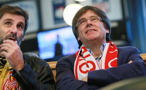 Ousted Catalan leader Carles Puigdemont watches Spanish soccer in Brussels