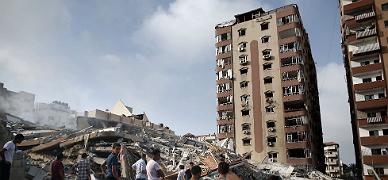 Los restos del edificio derribado por los aviones israelís.