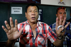 Presidential candidate Rodrigo Digong Duterte talks to the media before casting his vote at a polling precinct for national elections at Daniel Aguinaldo National High School in Davao
