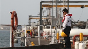 lpedragosa32915409 an iranian technician stands at an oil facility in160227165957