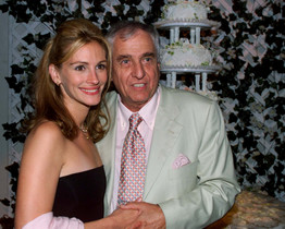 Actress Julia Roberts, star of the new comedy film  Runaway Bride, poses with the films director Garry Marshall at a party following the films premiere in Los Angeles