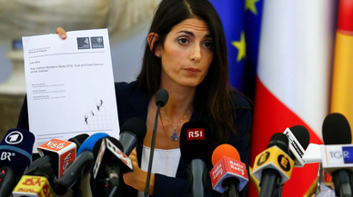 Rome's new mayor Raggi holds a document during a news conference in Rome