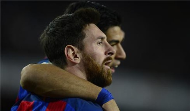 Leo Messi junto a Luis Súarez.