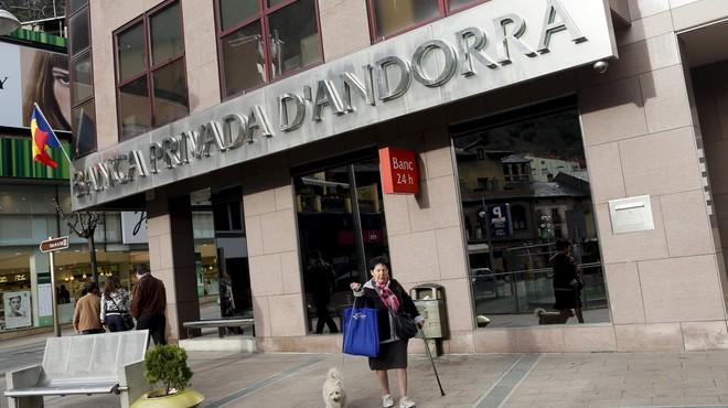 A woman walks past a BPA office in Andorra la Vella