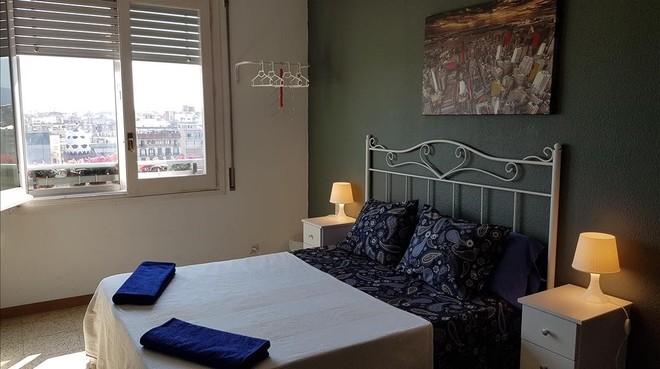Habitación de alquiler para viajeros en un piso del Fort Pienc, en Barcelona.