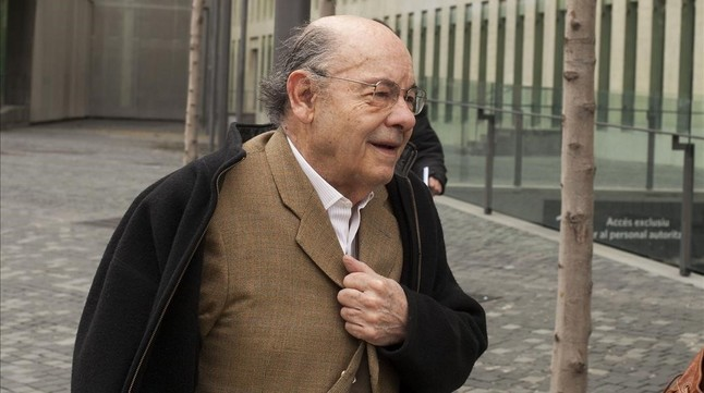 Félix Millet saliendo de la Ciutat de la Justicia, en marzo del 2013.