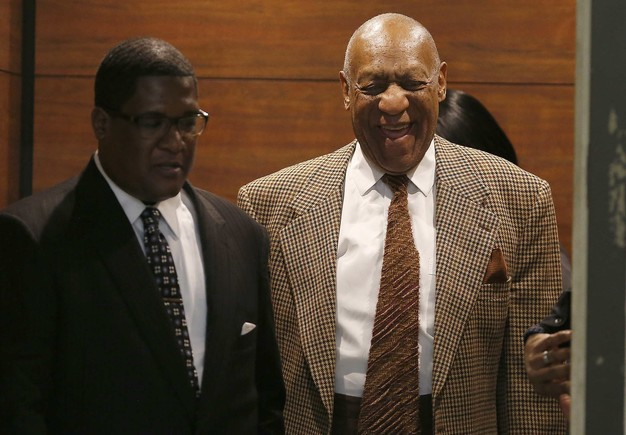 Cosby exits an elevator as he returns to court for a hearing in Norristown