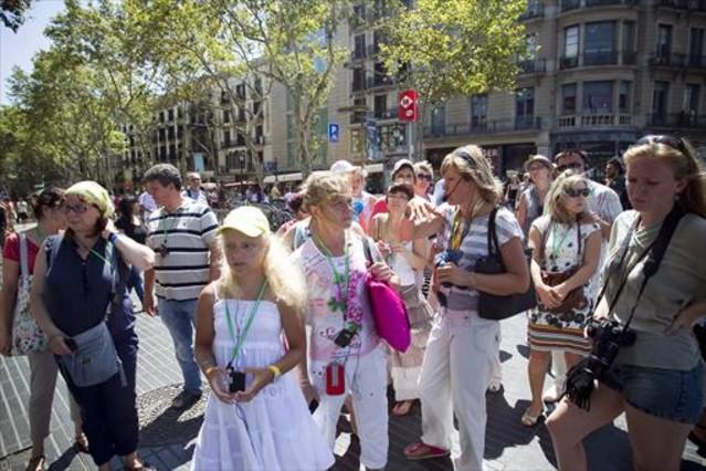 Un grupo de turistas rusos, de visita en Barcelona el pasado verano.