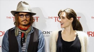 Johnny Deep y Angelina Jolie, en la presentaci�n en Madrid de 'The Tourist', en diciembre de 2010.