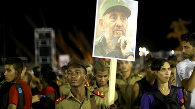 A cadet carries an image of former Cuban leader Fidel Castro at a tribute to Castro in Santiago de Cuba
