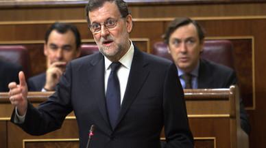 Rajoy contesta a Hernando (PSOE), en el Congreso de los Diputados.