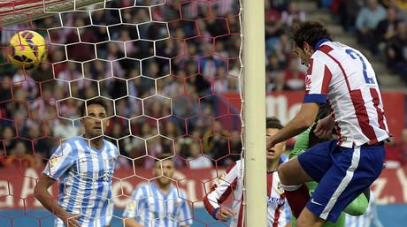 God�n aprovecha un centro de Tiago para marcar de cabeza y cerrar el marcador ante el M�laga