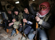 Rebel fighters ride a military vehicle, as they advance towards the northern Syrian town of al-Bab