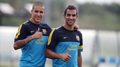 Los jugadores del Bar�a,Cristian Tello yMart�n Montoya, en un entrenamiento del 2013.