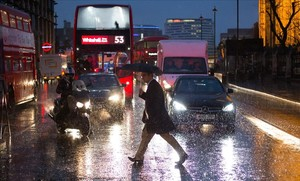 jjubierre36852458 a pedestrian walks in heavy rain near the houses of parliame170113104102