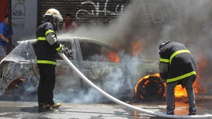 Disturbios en las inmediaciones del Congreso, el jueves 14 de diciembre, en Buenos Aires.